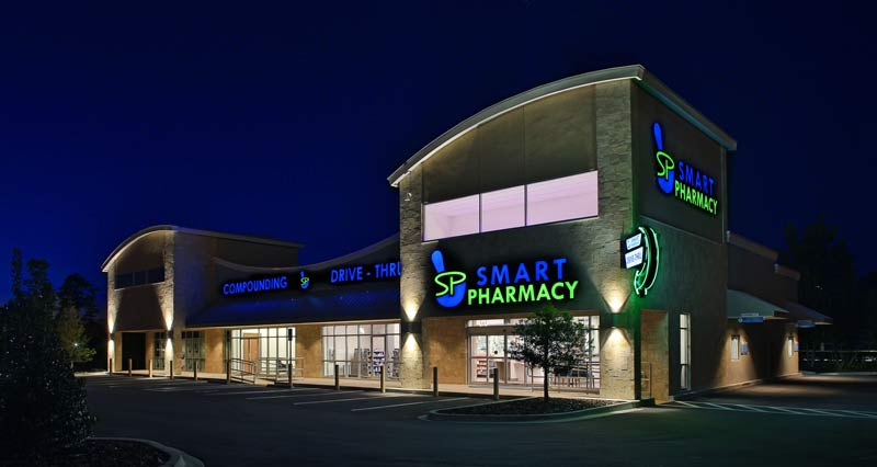 Smart Pharmacy exterior at night